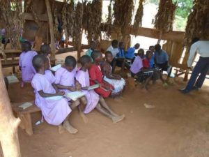 P.3 Students attending class in the grass thatched shed