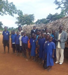 P.4 student standing in front of the classroom